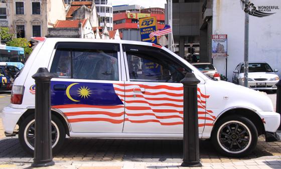 malaysian car with flag