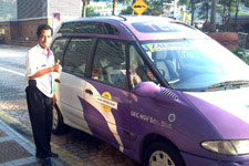 Premier taxi driver with his taxi
