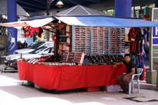 Street vendor in sunglasses