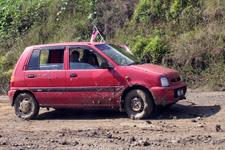 Car stuck in the mud in the Kinabatangan area